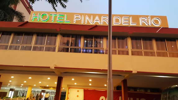 hotel facade with bright sign