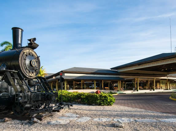 hotel facade with decorative old train