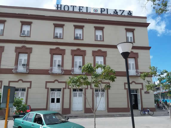 colonial facade with hotel sign