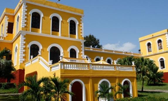 yellow colonial facade under blue sky