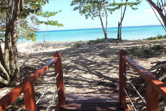 end of wooden path and  beach view