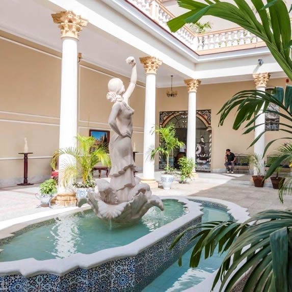 inner courtyard with fountain and marble sculpture