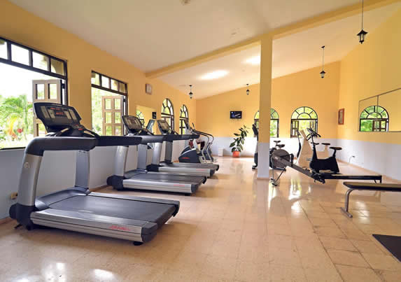 gym with treadmills and other