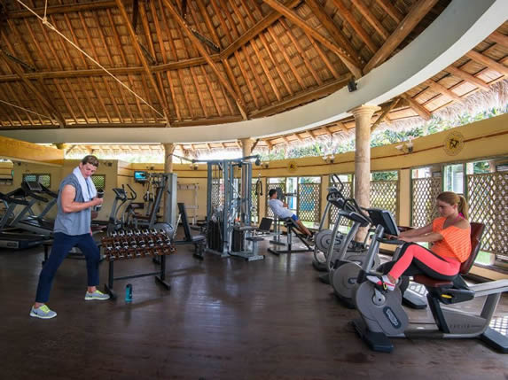 tourists in the gym under a guano roof