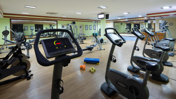 gym with exercise bikes and other equipment