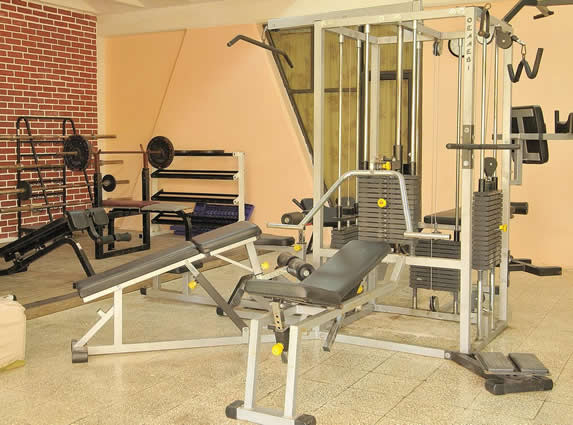 small gym with brick wall