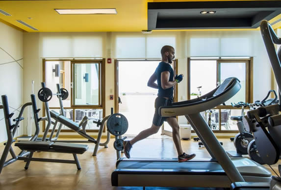 gym with treadmill and other equipment