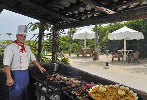 grill with food near the beach