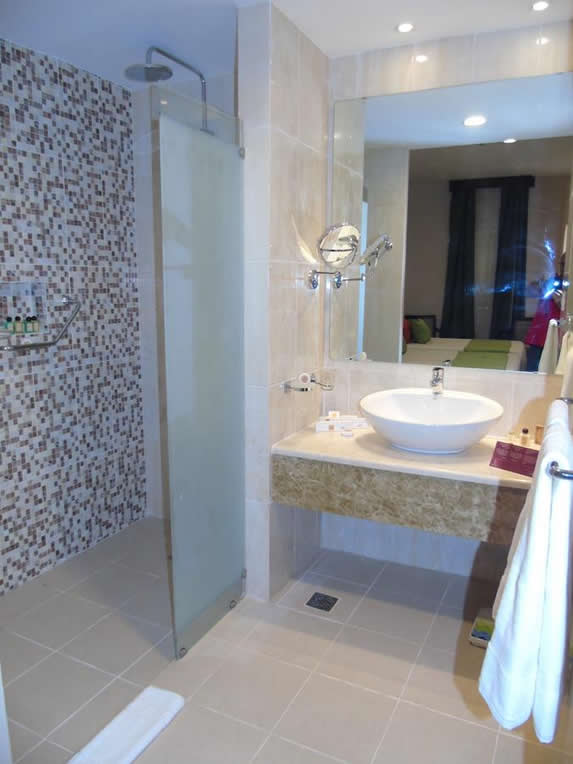 room bathroom with shower and mirror