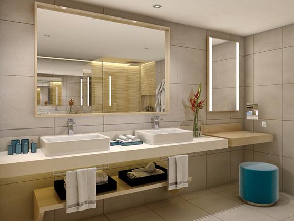 baño de la habitación con dos lavamanos