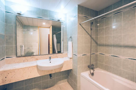 bathroom with marble furniture and mirror