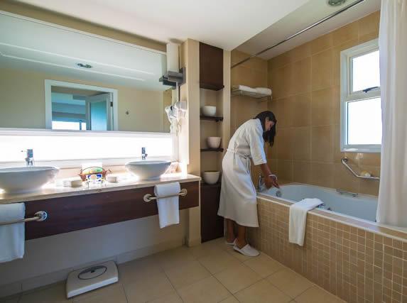 room bathroom with tub