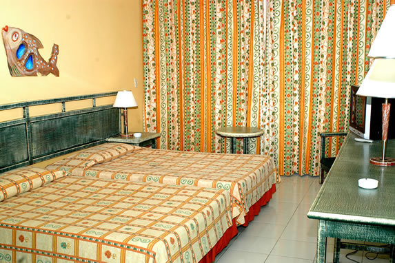 two-bedded room with wooden furniture