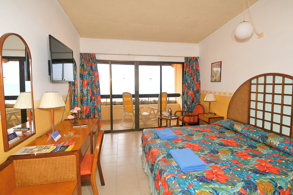 one bed room with balcony overlooking the sea