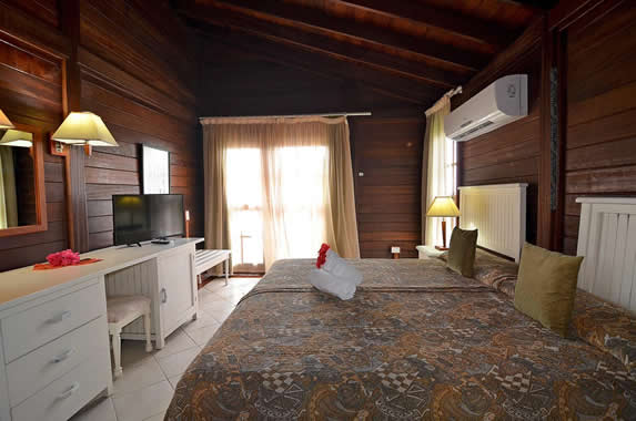 two-bed room with ceiling and wooden wall