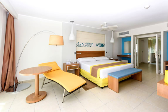 one bed room with wooden furniture
