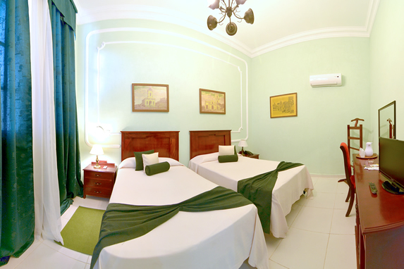 two-bed room with wooden furniture