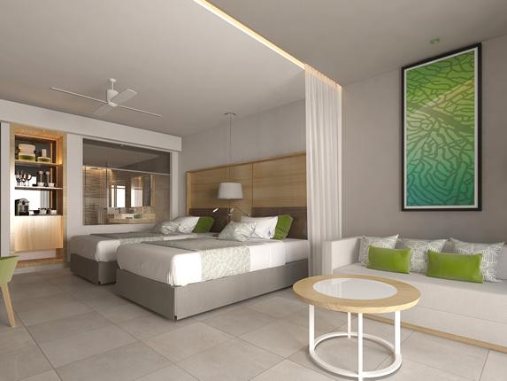 habitación de dos camas con sofá
