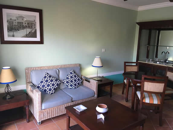 room with wooden furniture and sofa