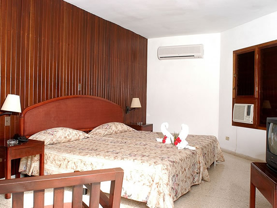one bed bedroom with wooden furniture