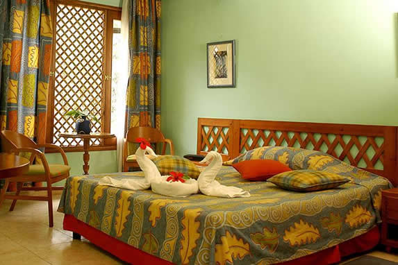 one bed room and wooden furniture