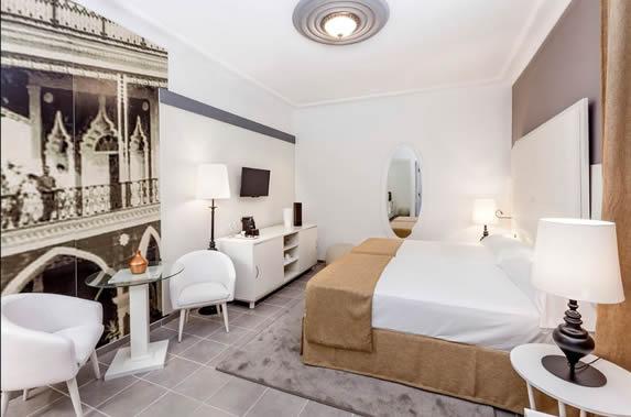 one bed room with white furniture