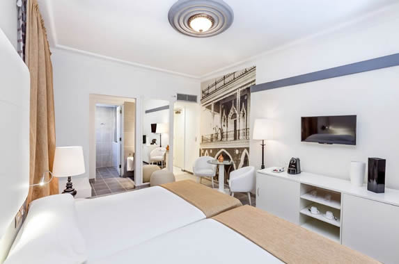 two-bed room with white furniture