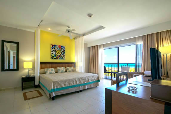 one bed room with balcony and sea view