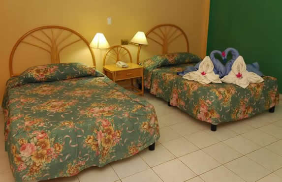 room with two beds and wooden furniture