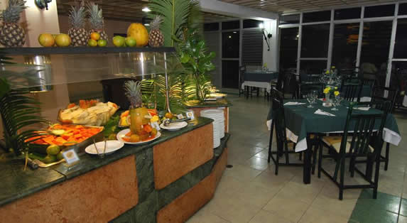 restaurant with wooden furniture and buffet table