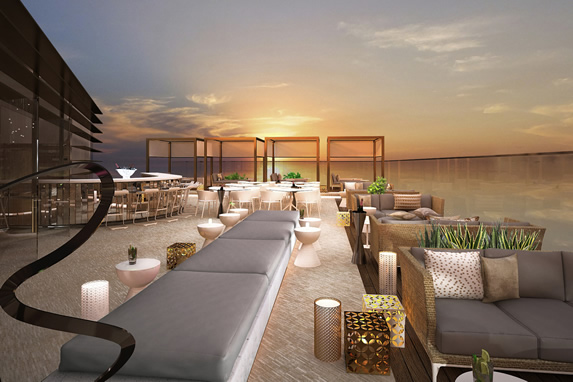 Terrace bar with beds to relax and a beautiful vie