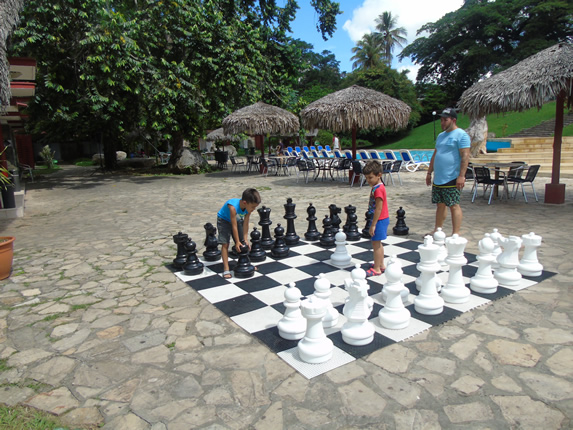 children playing giant chess on the floor