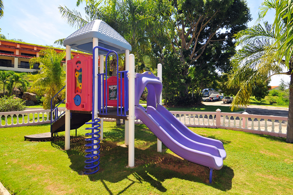 small playground for children surrounded by greene