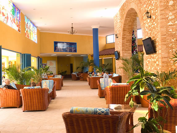 lobby with plants and colorful stained glass