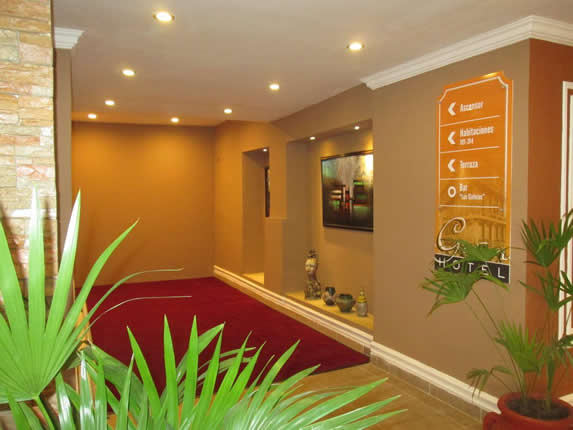 lobby with red carpet and decorative plants