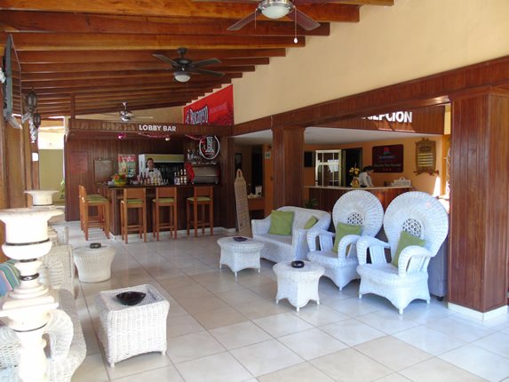 lobby bar with white furniture and wooden bar