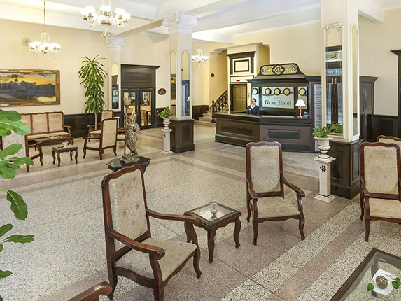 lobby with antique furniture and wooden reception