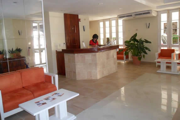 small lobby with wooden furniture and reception