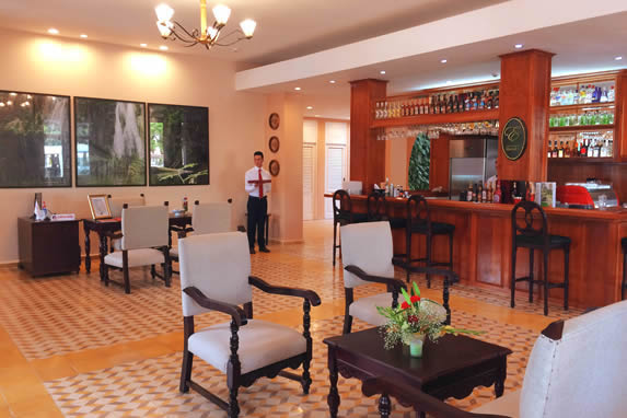 lobby with antique furniture and wooden bar