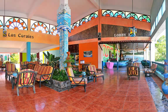 lobby decorated with colorful stained glass and fu