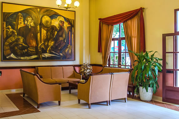 lobby with furniture and decorative painting