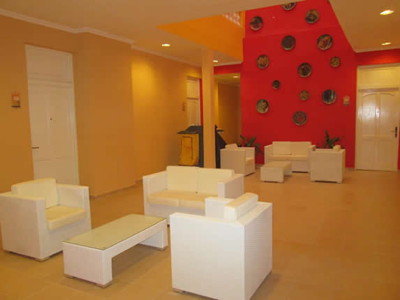 white furniture and red wall decorated with dishes