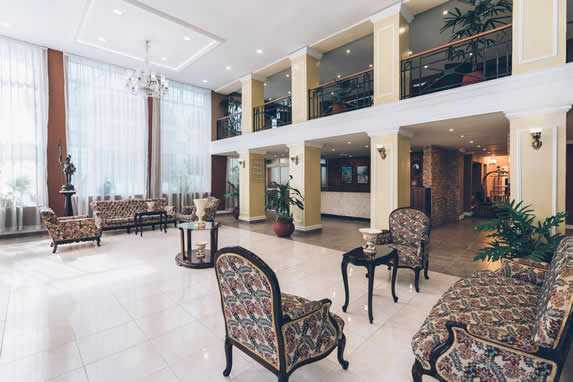 lobby with antique furniture and large windows