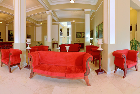 lobby with red furniture and reception desk