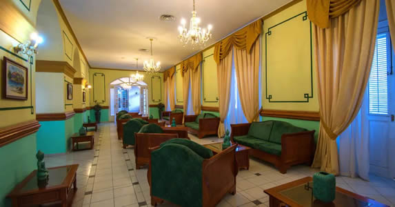 lobby with antique furniture and curtains