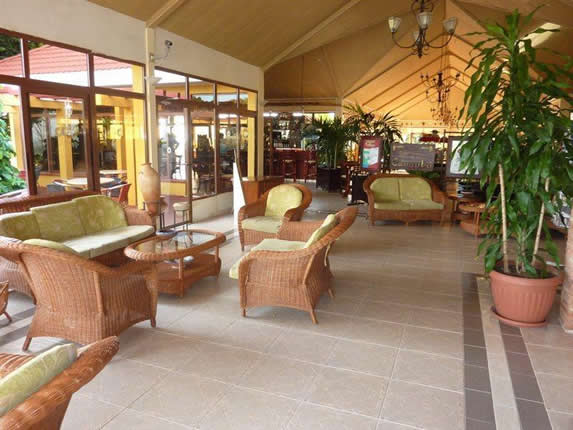 hotel lobby with armchairs and plants