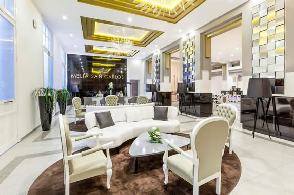 lobby with white furniture and rugs