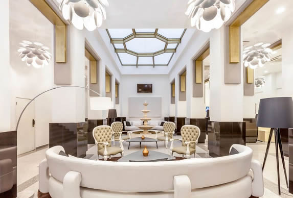 lobby with marble fountain and white furniture