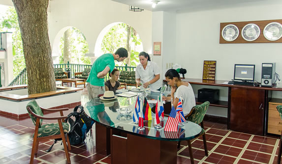 tourists in the lobby reception bureau