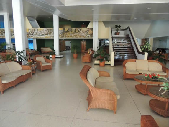 lobby with wicker furniture and columns
